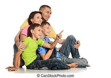 Friendly family on the floor on white background