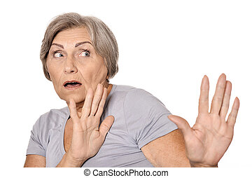 Scared elderly woman on white background