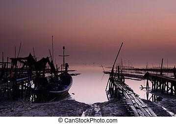 fishing boat with sunrise background