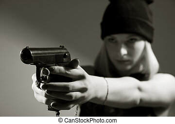 Portrait of a young girl with a gun in his hand Hooligan in...