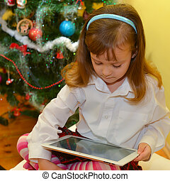 small girls with tablet