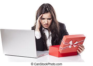 bad gift on the desk - disappointed young business woman at...