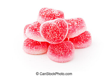 heap of heart-shaped candies isolated on white background