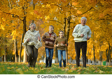 Older man and woman with grandchildren - Older man and woman...