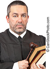 Serious male judge - A serious male judge holding the gavel...