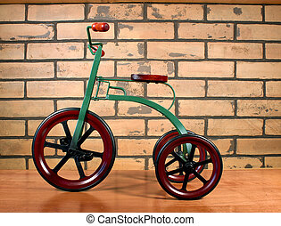 tricycle - vintage child's tricycle against a brick...