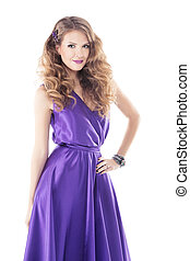 Woman with beautiful curly hairstyle in purple silk dress isolated over white background