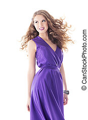 Woman beautiful portrait in purple silk dress, long hairs