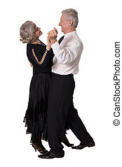 Elegant elderly couple dancing on white