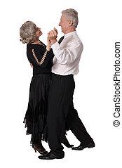 Elegant elderly couple dancing on white