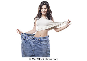 diet - girl posing in big pants on white background