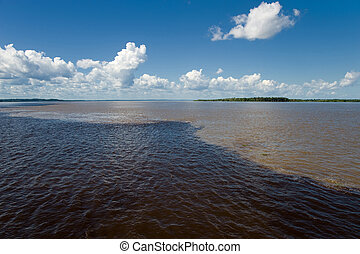 Meeting of Waters in the Amazon in Brazil - Meeting of...