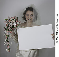 Pretty young bride holding sign