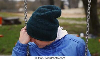Sorrowful teenage boy