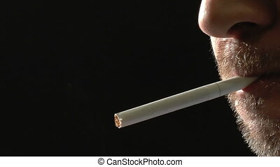 Unshaved face man smoking cigarette - Unshaved face of man,...