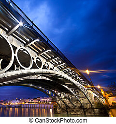Seville, panorama of the riverside under the Triana Bridge....