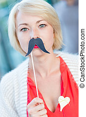 Woman with fake mustache - Portrait of girl wearing fake...
