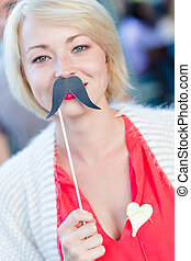 Woman with fake mustache. - Portrait of girl wearing fake...