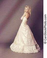 Bride over gray background, studio shot.