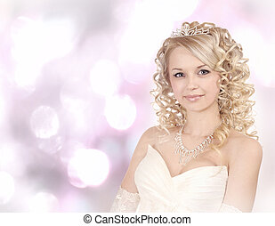 Smiling young bride on light bokeh background - Portrait of...