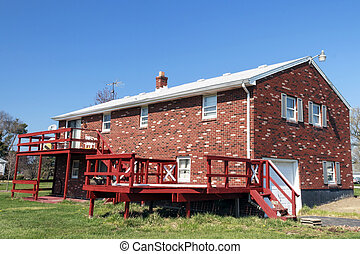 House Deck - Back side of a beautiful brick house with a...