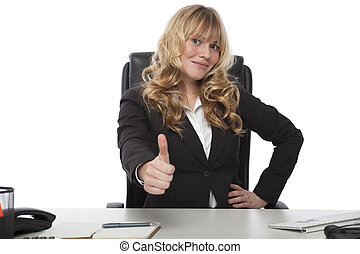 Motivated businesswoman giving a thumbs up - Motivated...
