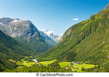 Village at the foot of mountain in Norway - Small village in...