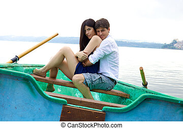 Happy couple in love in vacation on little boat