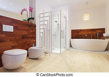 Bright stylish bathroom with pink orchid
