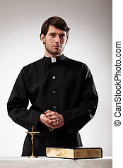 Handsome reverend with crucifix and the Bible - Handsome...