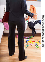 Businesswoman surprised mess at home - Young active mother...