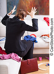 Woman is frustrated of mess at home