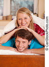 Marriage in pajamas - Close up of smiling marriage in...