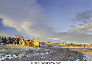 back country road over prairie in northern Colorado with...