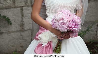 Bridal bouquet of peonies