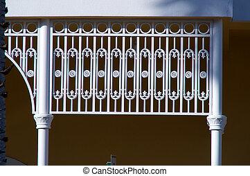ornate white wrought iron gate