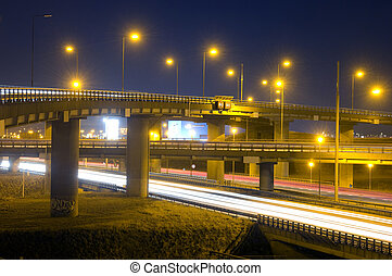 Motorway Overpass - A motorway junction at night, with...