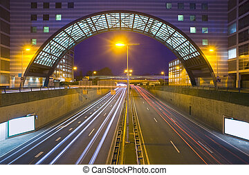Inner city highway - An inner city highway at night with an...