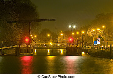 drawbridge at night - A drawbridge at night during a shower...
