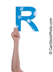 Person Holding R - A Person Holding an R with Snowflakes,...