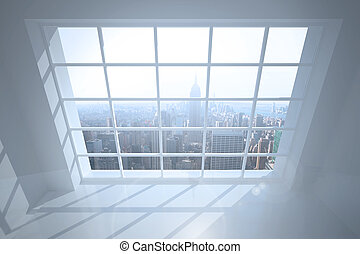 Room with large window showing city