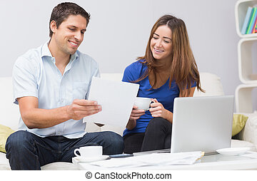 Couple paying their bills online at home