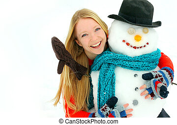 Woman and Snowman Outside in Winter - a young woman in her...