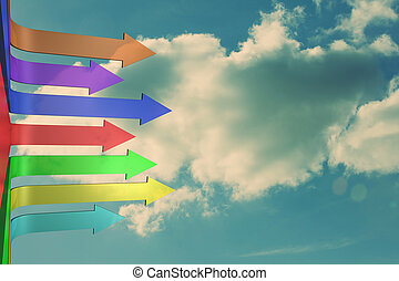 Colorful arrows pointing against sky
