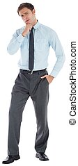 Thoughtful businessman with hand on chin on white background