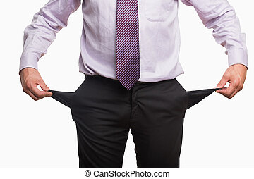 Mid section of a businessman with pockets pulled out over...