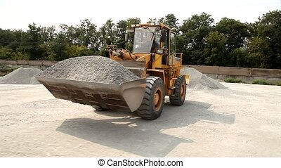 excavator transports rubble
