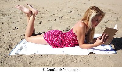 Female Sundress Beach Book - Female lying on the beach in a...