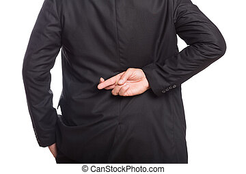 Mid section of a businessman with crossed fingers over white...