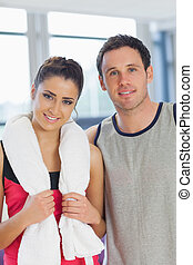 Portrait of a fit young couple in a exercise room